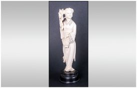 Chinese Carved Ivory Figure Of Quan Yin - Holding A Lotus Branch And A Basket Of Flowers. Raised