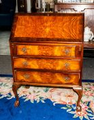 Walnut Queen Anne Style Bureau with fitted interior below three long drawers on carved cabriole