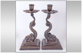 Pair of Bronze Dolphin Candlesticks, each base comprising the bewhiskered dolphin head resting on