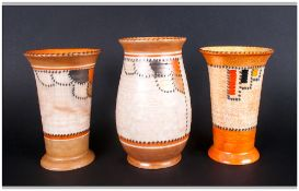 Crown Ducal Vases, 3 in total. 'Stitch Patch' Pattern Number 3274. Vertical stripes enamelled in