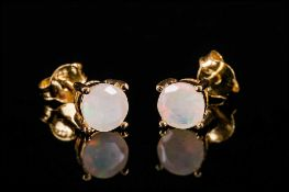 Faceted Opal Stud Earrings, two round cut opals, totalling .5ct, set in 14ct gold vermeil and silver