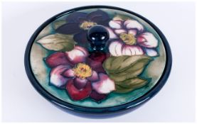 Moorcroft 'Clematis' Pattern Powder Bowl, the cover decorated with three clematis flowers of pink,