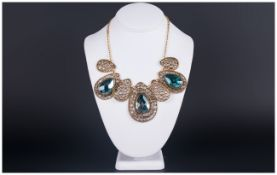 Sea Blue Crystal Piece and Antique Gold Metal Statement Necklace, comprising three pear cut sea blue