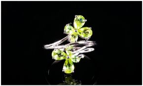 Peridot Butterfly Crossover Ring, each end of the crossover shank of rhodium vermeil and silver