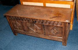 Antique Oak Coffer with a Lift up Lid, To The Front Carved with a Geometric Floral Design In Three