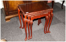 Nest Of Three Tables In The Queen Anne Style with glass tops on carved cabriole legs, Mahogany