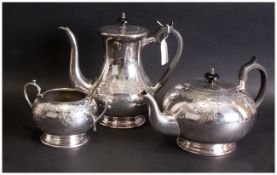 Three Piece EPNS Plated Tea Service, with engraving to the body. Melon Shaped with ebony handles.