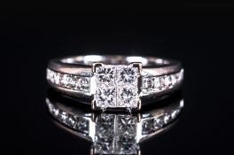 18ct White Gold Diamond Set Ring, The central four claw raised platform set diamonds with