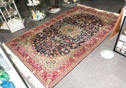 A Turkish Handmade Carpet In The Persian Style with a central Medallion blue ground with floral