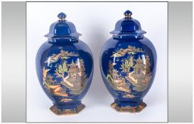 A G Harley Jones Pair of Large Chinoiserie Cover Vases, the hexagonal, bulbous bodies decorated with