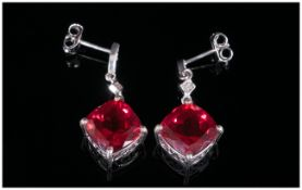 Ruby Colour Quartz and Diamond Drop Earrings, 8.75cts of the ruby red quartz in two cushion cuts,