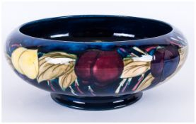 WITHDRAWN // Moorcroft 'Plum and Wisteria' Pattern Bowl, with inverted rim and low foot, a band of