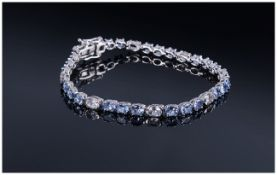 Tanzanite and White Topaz Tennis Bracelet, oval cut tanzanites, the gemstone found only in the