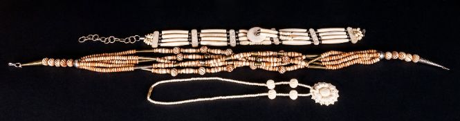 Three Various African Carved Bone Necklaces, comprising a five row, turned and stained bead