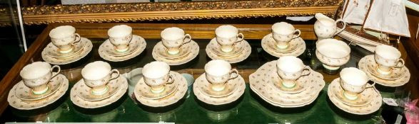 Paragon Tea Set 'Peacock' Design, Brown stamp to base. Gilt decoration of peacock feathers on a
