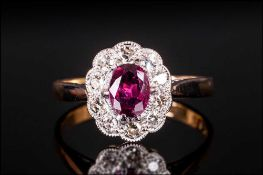 18ct Gold And Platinum Set Ruby & Diamond Cluster Ring, set with 6x4 ruby of good colour and 10-8