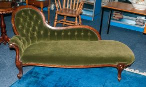 Victorian Style Chaise Lounge Settee with a shaped spoon back and shaped base arm. On carved