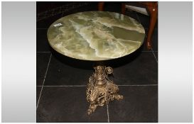 Onyx Top Coffee Table with a French gilded brass base. In the Ecclesiastical style. With enamel
