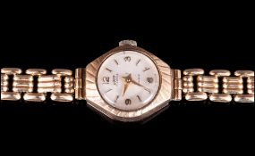 A Swiss 9ct Gold Cased Ladies Manual-Wind Wrist Watch. Attached to a 12ct Gold Plated Bracelet. In