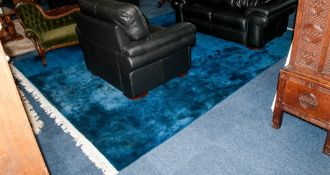 A Large Blue Washed Chinese Carpet of Singular Colour with a White Fringed Edging Incised
