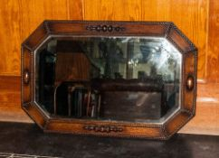 A 1930's Jacobean Style Octagonal Shaped Wall Mirror In Oak. Bevelled Glass.