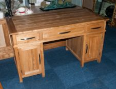 A Contemporary Bleached Oak Knee Hole Desk with three drawers above 2 cupboards below. 54x30''