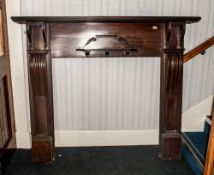 Edwardian Mahogany Fireplace with two side corbels shaped with a small central bracket to the front.