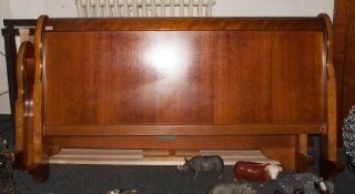 Large Sleigh Bed In Walnut Finish, king size.With wooden slats to the base. Fitted to a metal