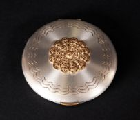 1950's Vogue Compact in a polished steel case with gilt metal roundel. Stamped 'Panities'. Made in