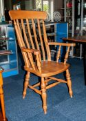Beech Wood Lancashire Slatted Back Kitchen Arm Chair of Typical Form on Turned Legs.