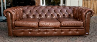 Brown Leather Three Seater Button Back Chesterfield Settee with three loose seat covers