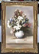 Large Floral Oil Painting On Board With Flowers In A Vase monogrammed J.L in swept Gilt Frame.