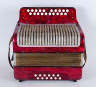 Small Vintage Accordian By Double Ray Deluxe Model in a red plastic outer body