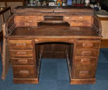 Four Oak Tambour Front Roll Top Desk with a fitted interior with a 4 drawer pedestal base at each