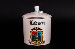Goss Crested Ware Tobacco Jar and Cover, the cylindrical white jar showing the crest of Johannesburg