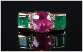 A Fine 18ct Gold Set Ruby & Emerald Ring with diamond spacers. The central faceted ruby of excellent