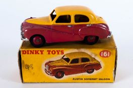 Dinky Toys No 161 Austin Somerset Saloon Diecast Model. Red Lower Body With Yellow Upper Body And