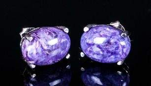 Russian Charoite Pair of Stud Earrings, each earring comprising a solitaire oval cut cabochon of the