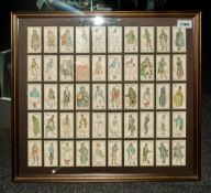 Framed Set of 50 Period Characters From Dickens Cigarette Cards Issued by John Player & Sons. In
