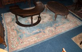 Room Size Chinese Style Rug, with pale blue background and tassled edge.