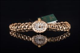 Ladies 9ct Gold Wrist Watch with 9ct Gold Integral Bracelet. Fully Hallmarked. As New Condition with