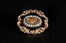 Early Victorian Pinch beck Mourning Brooch, Set with Pearls. Classical Shaped Border. c.1840's. 1.25
