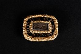 A Small Early Victorian Gold Mourning Brooch with Ornate Embossed Border. Date 1839. 1.25 Inches