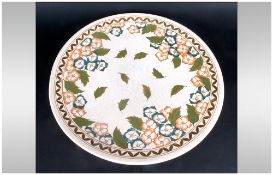 A Fine Charlotte Rhead Bursley Ware Tube Lined Charger A variation on pattern number TL4, tube lined