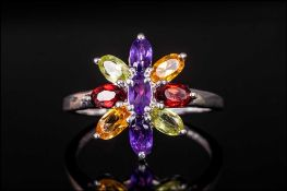 Multi Gemstone Flower Ring, the petals formed from marquise cut red garnets, amethysts, peridots and