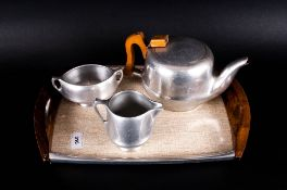 Picquot Ware Teapot, Sugar Bowl, Cream/Milk Jug, together with tray.
