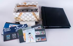 Blank Stanley Gibbons Cover Album plus quantity of mint GB stamps, many in presentation packs.