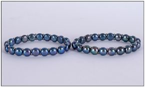 Pair of Peacock Fresh Water Pearl Bracelets, each matching bracelet comprising a row of peacock