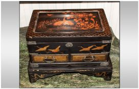 Japanese Lacquer Table Casket On Stand, decorated with flying crane birds amongst foliage. Fitted