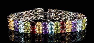 Amethyst, Red Garnet, Peridot Multi-Gemstone Bracelet, comprising three rows of of oval cuts in